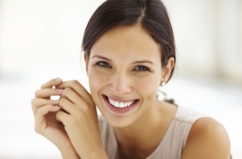 Gorgeous young female smiling confidently